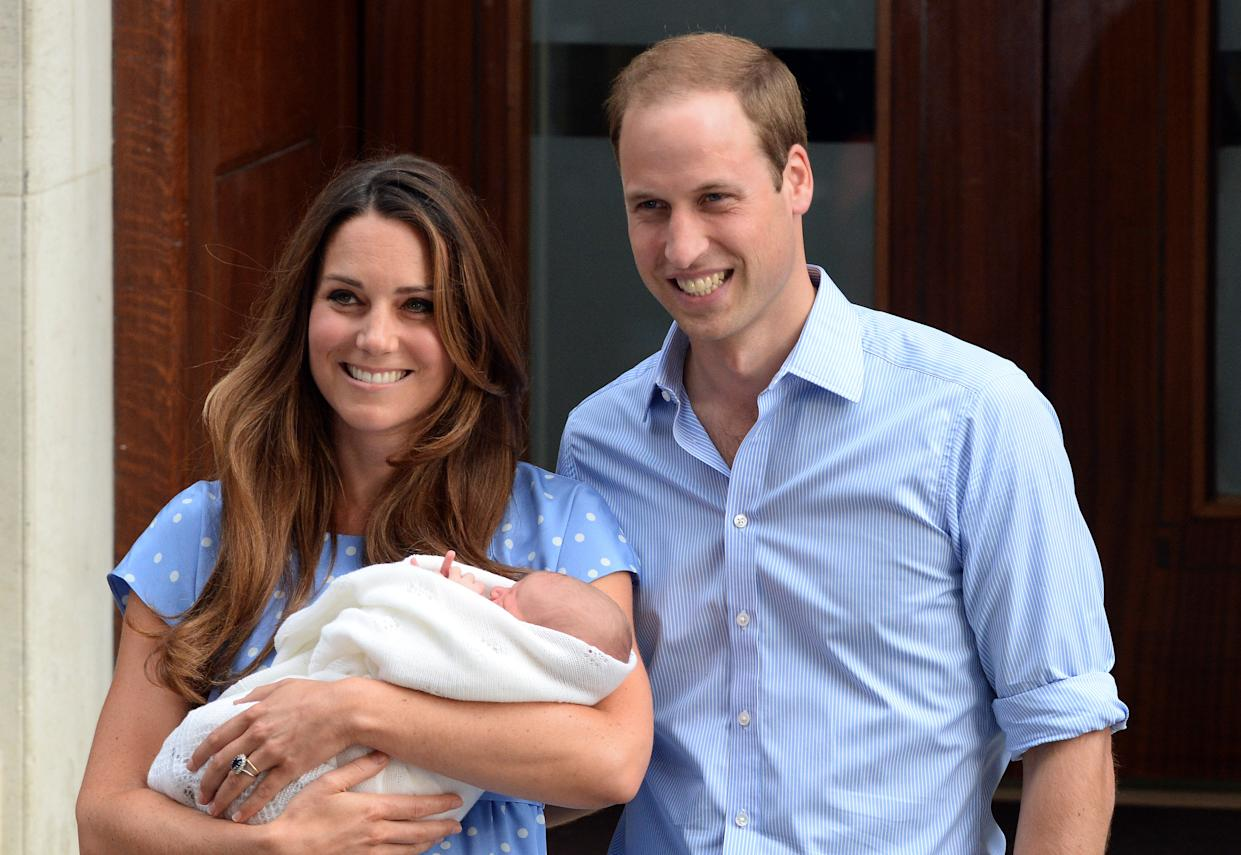 Prince William, Duke of Cambridge and Catherine, Duchess of Cambridge leave the Lindo Wing of St. Mary's hospital with their newborn baby son on July 23, 2013'