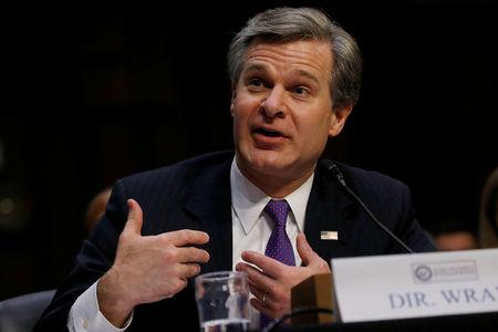 "Federal Bureau of Investigation (FBI) Director Christopher Wray testifies during a Senate Intelligence Committee hearing on ""Worldwide Threats"" on Capitol Hill in Washington, U.S., February 13, 2018. REUTERS/Leah Millis"