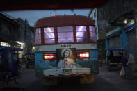 A Sacred Heart of Jesus Christ image decorates the back of a public bus in Iquitos, Peru, early Saturday, March 20, 2021. Almost a year ago, dozens of victims were clandestinely buried in Iquitos, a city in Loreto state in the heart of the Peruvian Amazon. Local authorities approved the burials but never told the families, who believed their loved ones were in a local cemetery — and only a couple of months later they found out the truth. (AP Photo/Rodrigo Abd)