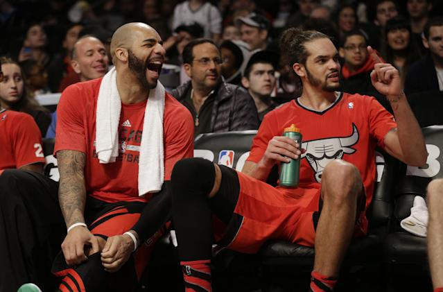 Chicago Bulls' Carlos Boozer, left, and Joakim Noah relax on the bench near the end of the second half of the NBA basketball game against the Brooklyn Nets at the Barclays Center Wednesday, Dec. 25, 2013, in New York. The Bulls defeated the Nets 95-78.(AP Photo/Seth Wenig)