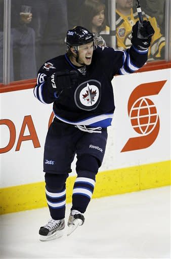 Winnipeg Jets' Bryan Little (18) celebrates against the Boston Bruins during an NHL hockey game, Friday, Feb. 17, 2012, in Winnipeg, Manitoba. Little contributed two goals as the Jets won 4-2. (AP Photo/The Canadian Press, Trevor Hagan)