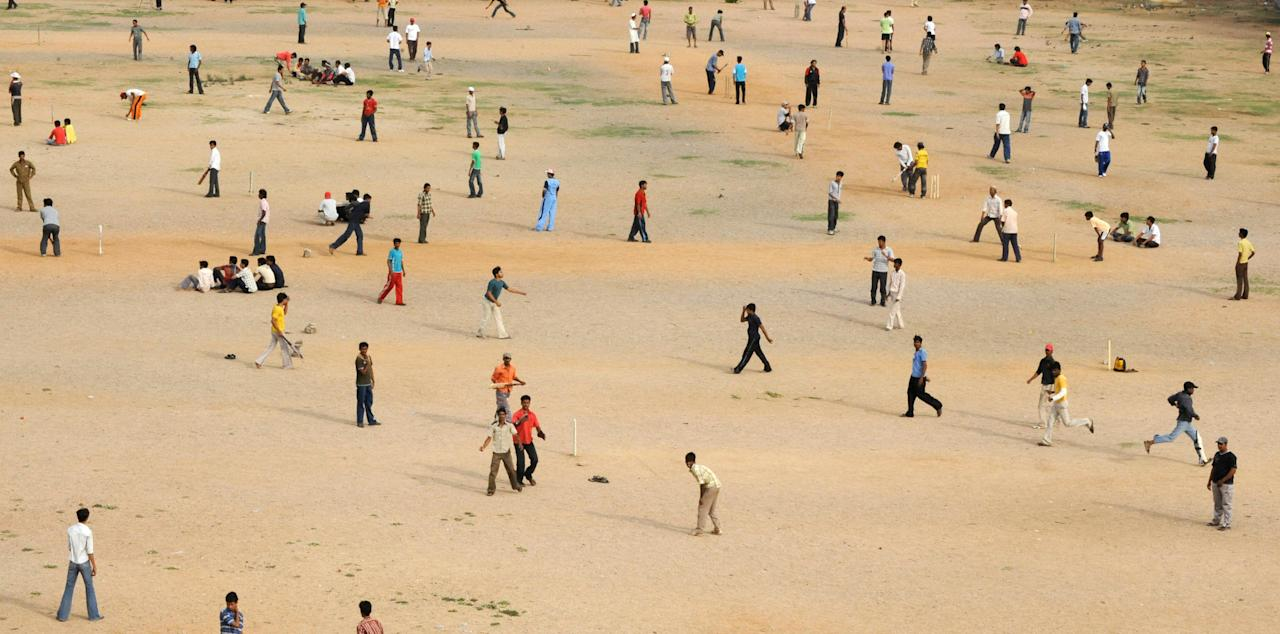 Indian youths play cricket at the NTR grounds in Hyderabad on May 24, 2009. (NOAH SEELAM/AFP/Getty Images)