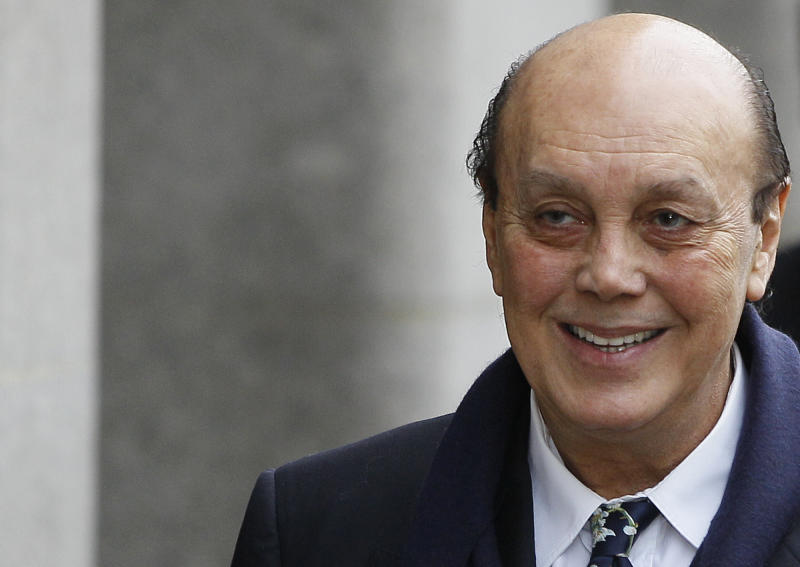FILE - This is a Monday, Jan. 23, 2012, file photo of the founder of the collapsed Polly Peck business empire Asil Nadir as he arrives at The Old Bailey court in London. Former fugitive tycoon Asil Nadir was found guilty at the Old Bailey Monday Aug. 20, 2012 of  three counts of theft. (AP Photo/Kirsty Wigglesworth.File)