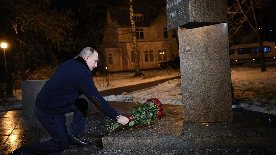 President Putin laying flowers on a grave