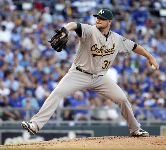 Oakland Athletics starting pitcher Jon Lester throws during the first inning of a baseball game against the Kansas City Royals, Tuesday, Aug. 12, 2014, in Kansas City, Mo. (AP Photo/Charlie Riedel)