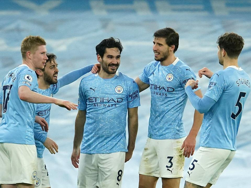 Manchester City players celebrate en route to the 2020/21 Premier League title (Getty Images)