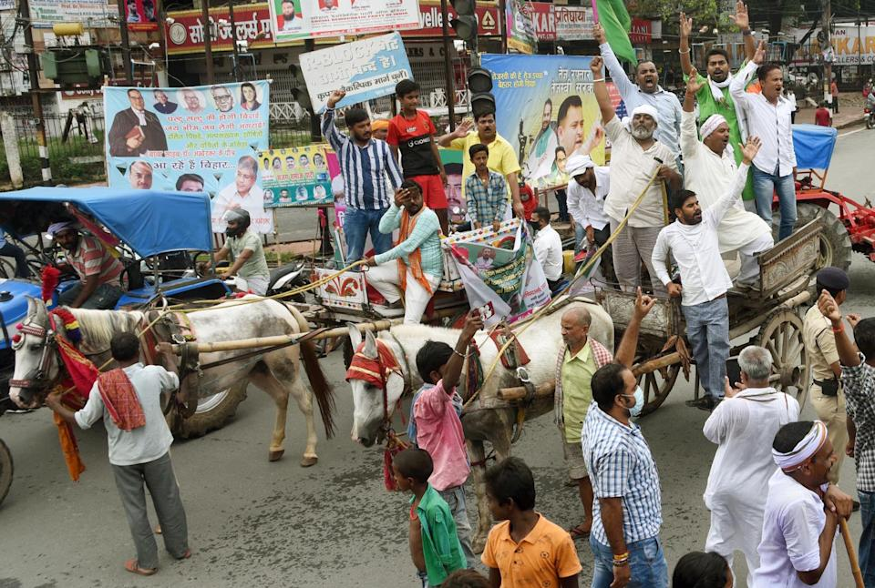 JAP party supporters blocking Dak Bungalow crossing while taking part in the Bharat Bandh in protest against recently passed farm bills, on September 25, 2020 in Patna, India. The two bills - the Farmers (Empowerment and Protection) Agreement on Price Assurance and Farm Services Bill, 2020 and the Farming Produce Trade and Commerce (Promotion and Facilitation) Bill, 2020 - were passed by the Rajya Sabha despite uproar and strong protest by the Opposition parties in the house. (Photo by Santosh Kumar/Hindustan Times via Getty Images)