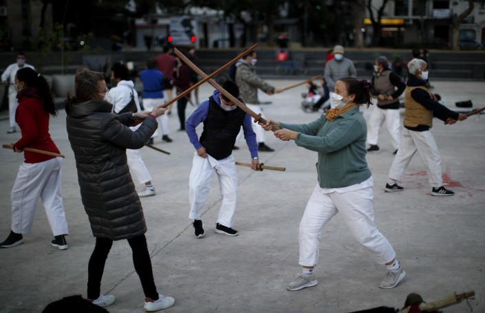 People practice aikido at a park amid the COVID-19 pandemic in Buenos Aires, Argentina, Wednesday, June 2, 2021. (AP Photo/Natacha Pisarenko)