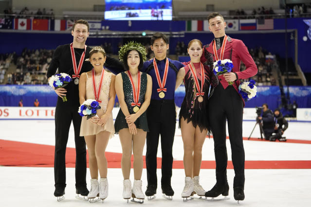 CORRECTS NAMES OF RUSSIAN PAIR - Silver medalists Kirsten Moore-Towers and Michael Marinaro of Canada, left, gold medalists Sui Wenjing and Han Cong of China, center, and bronze medalists Anastasia Mishina and Aleksandr Galliamov of Russia pose with their medals at a victory ceremony after the pairs free skating program during the ISU Grand Prix of Figure Skating in Sapporo, northern Japan, Saturday, Nov. 23, 2019. (AP Photo/Toru Hanai)
