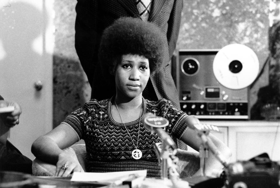 <p>Aretha Franklin is shown at a news conference sporting a printed top and stretched-out Afro. (AP Photo) </p>