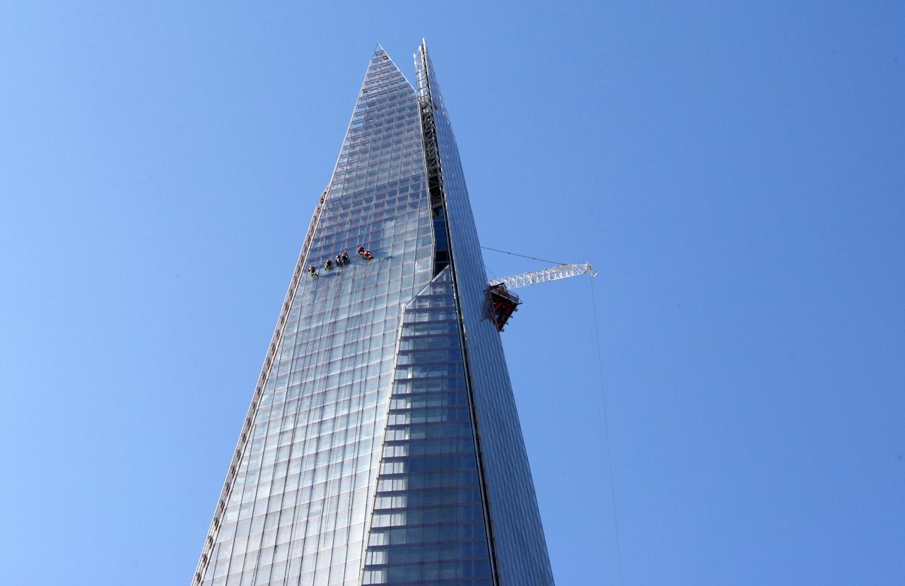 Workmen clean the exterior of The Shard on April 16, 2012 in London, England.  (Photo by Dave J Hogan/Getty Images)