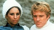 """<p>Can love surmount political differences? Katie Morosky (Barbara Streisand) and Hubbell Gardiner (Robert Redford) meet in college, and are drawn to each other despite being essentially polar opposites. Their relationship continues, on and off, for the next few decades, with each phase testing their values and their commitment to each other.</p><p><a class=""""link rapid-noclick-resp"""" href=""""https://www.amazon.com/Way-We-Were-Barbra-Streisand/dp/B000W453KQ?tag=syn-yahoo-20&ascsubtag=%5Bartid%7C10072.g.33383086%5Bsrc%7Cyahoo-us"""" rel=""""nofollow noopener"""" target=""""_blank"""" data-ylk=""""slk:Watch Now"""">Watch Now</a></p>"""