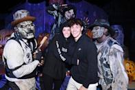 <p>holding each other close at Knott's Scary Farm in Buena Park, California, on Sept. 18.</p>