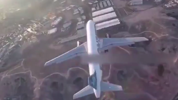 Drone video documents a disturbingly close encounter with passenger plane