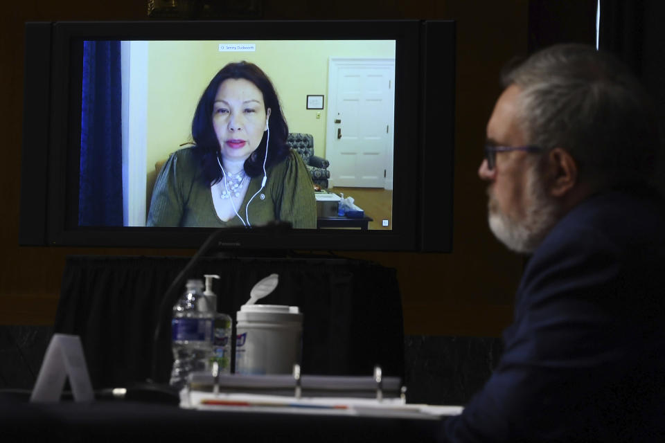 Sen. Tammy Duckworth, D-IL, speaks virtually during a Senate Environment and Public Works Committee oversight hearing to examine the Environmental Protection Agency, Wednesday, May 20, 2020 on Capitol Hill in Washington, with Andrew Wheeler, administrator of the Environmental Protection Agency, left. (Kevin Dietsch/Pool via AP)