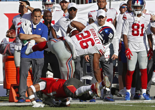 New York Giants running back Saquon Barkley (26) gets hit by Tampa Bay Buccaneers safety Mike Edwards (34) during the first half of an NFL football game Sunday, Sept. 22, 2019, in Tampa, Fla. Barkley left the game. (AP Photo/Mark LoMoglio)