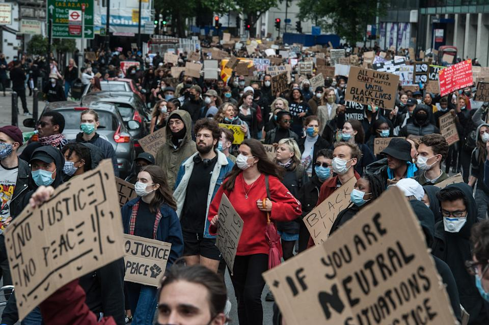 LONDON, ENGLAND - JUNE 7: Protesters march down Vauxhall Bridge road as thousands join a second day of Black Lives Matter protest on June 7, 2020 in London, United Kingdom. The death of an African-American man, George Floyd, while in the custody of Minneapolis police has sparked protests across the United States, as well as demonstrations of solidarity in many countries around the world. (Photo by Guy Smallman/Getty Images)