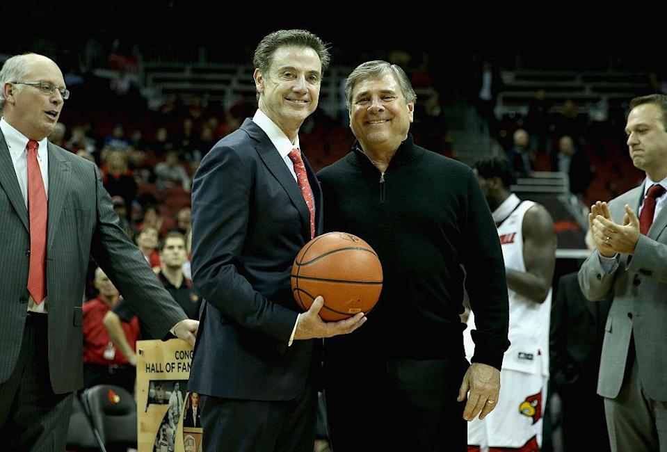 A few years after Rick Pitino celebrated his 700th career win with athletic director Tom Jurich, both are out at Louisville. (Getty)