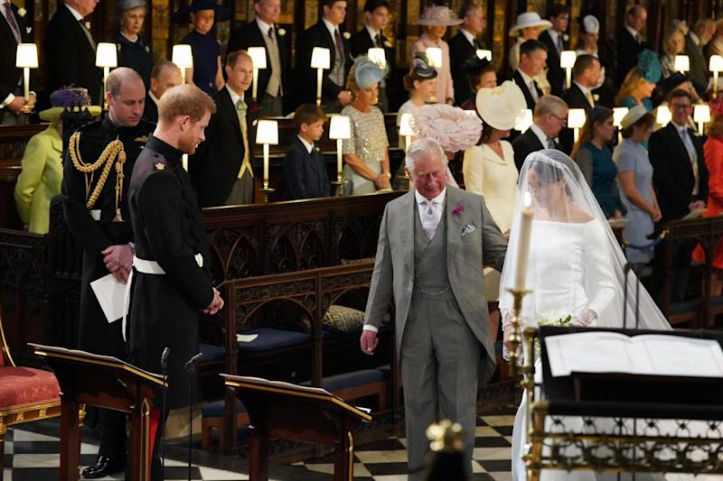 Prince Charles walking Meghan down the aisle (PA Wire/PA Images)