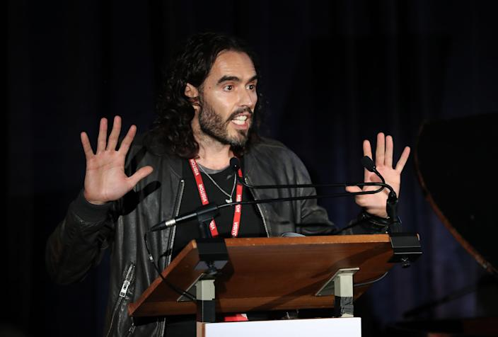 Russell Brand performs during the 'Letters Live' event at HMP Brixton, London.