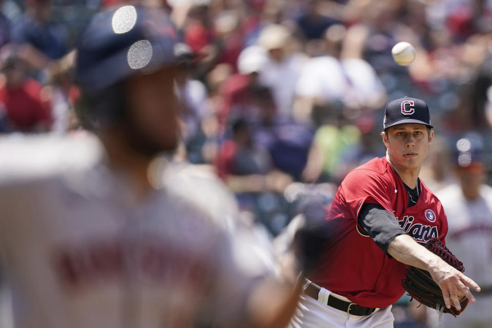 Cleveland Indians relief pitcher Phil Maton throws out Houston Astros' Abraham Toro at first base in the sixth inning of a baseball game, Sunday, July 4, 2021, in Cleveland. (AP Photo/Tony Dejak)