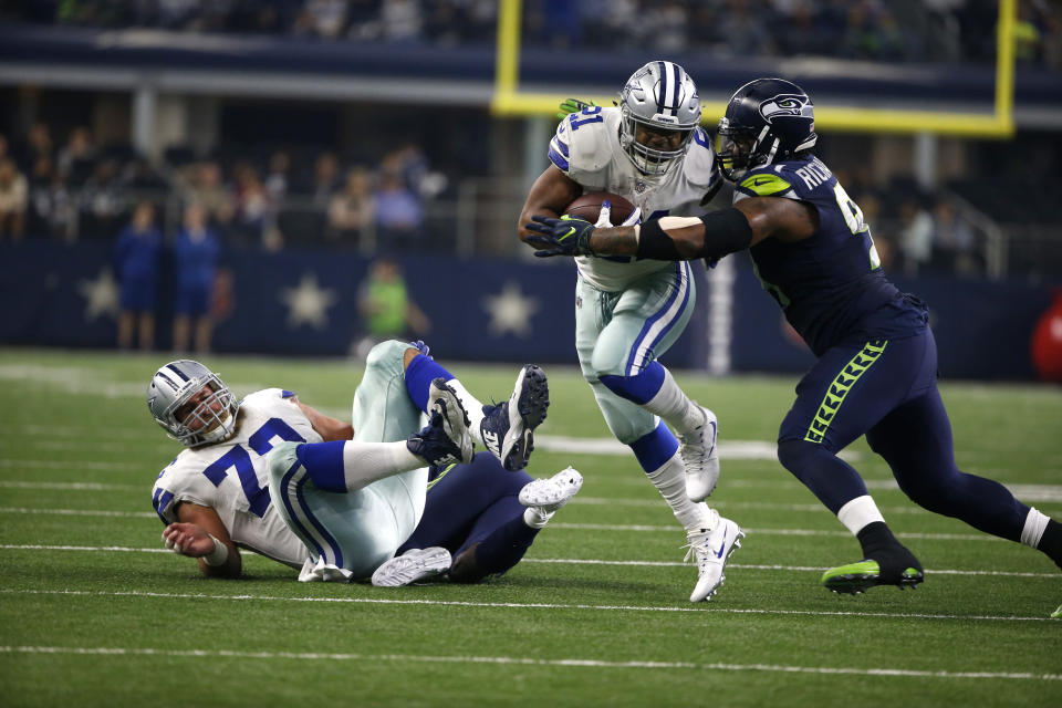 Dallas' Ezekiel Elliott (21) is one of the NFL's most violent runners. Will the new helmet rule strike him at the wrong time? (AP)