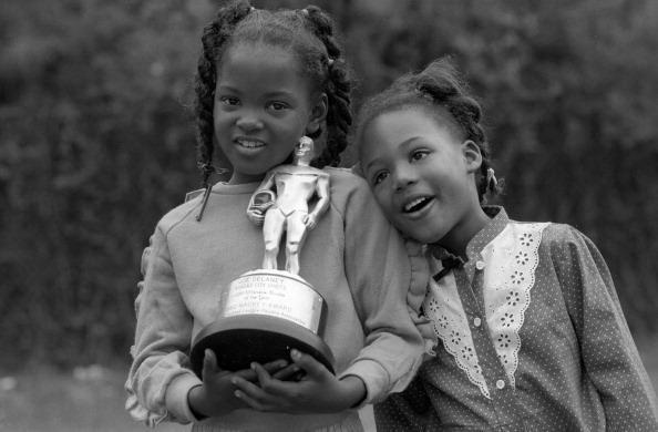 Joe Delaney's two oldest daughters, Tamika and Crystal, in 1983, holding their father's Mackey Award (Photo by Brian Lanker /Sports Illustrated/Getty Images)