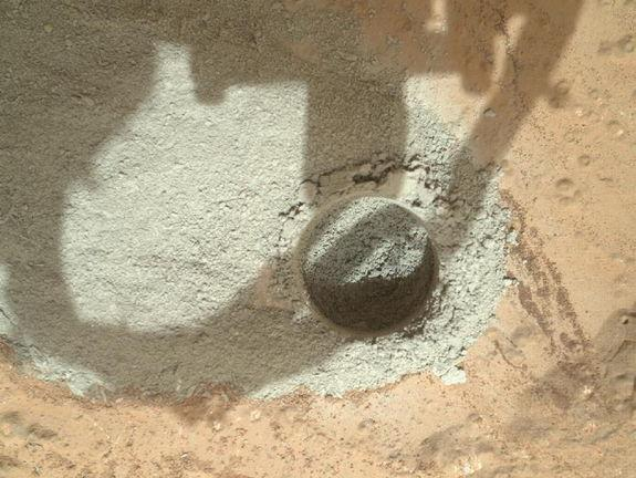 "In an activity called the ""mini drill test,"" NASA's Mars rover Curiosity used its drill to generate this ring of powdered rock for inspection in advance of the rover's first full drilling (Feb. 6, 2013). Image released Feb. 7, 2013."