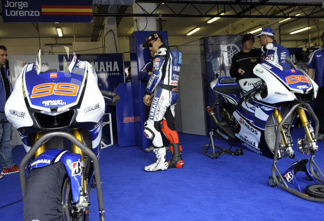 Yamaha Factory Racing team's rider Spaniard Jorge Lorenzo looks at his bike in the pits before the start of the Moto GP free practice 3 of the Portuguese Grand Prix in Estoril, outskirts of Lisbon, on May 5, 2012. AFP PHOTO / MIGUEL RIOPAMIGUEL RIOPA/AFP/GettyImages