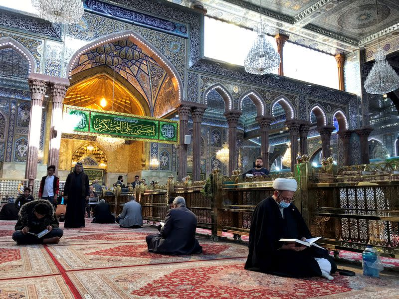 Worshippers pray and read religious books at the Imam Hussein shrine, one of the most revered sites for ShiÕite Muslims in the holy city of Kerbala