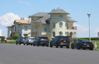 Cars are parked on an oceanfront street in Deal, N.J., on May 15, 2021. The Jersey shore town has introduced a law that would restrict parking on many streets closest to the ocean to residents-only. Some shore towns in New Jersey and other states have used parking restrictions as a way to keep outsiders off their beaches. (AP Photo/Wayne Parry)