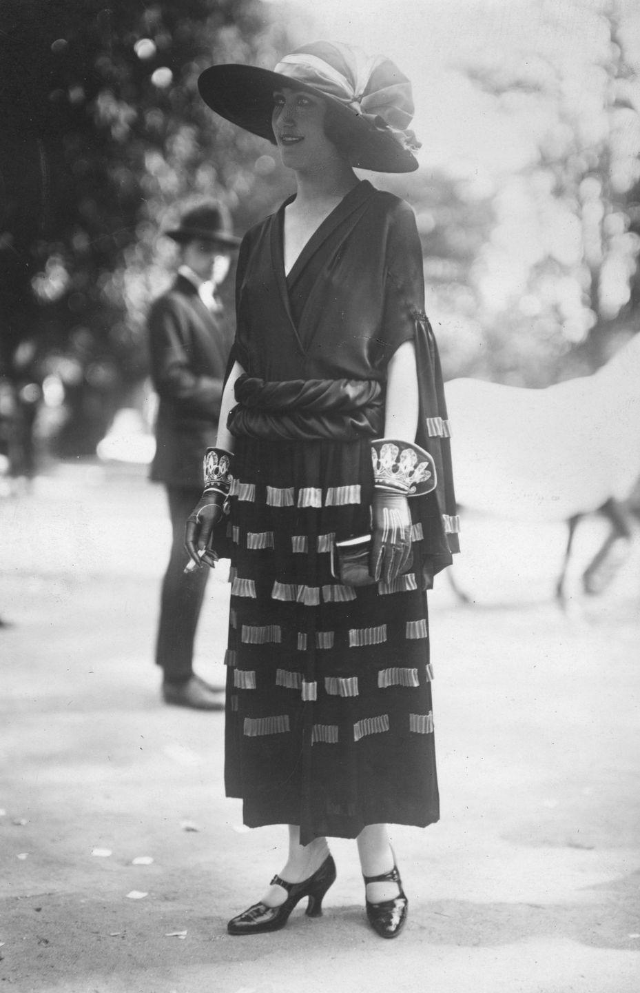 <p>The woven skirt is a standout piece, but it looks even more chic coupled with the gloves that may or may not have inspired Lady Gaga's 2015 Oscar look. </p>
