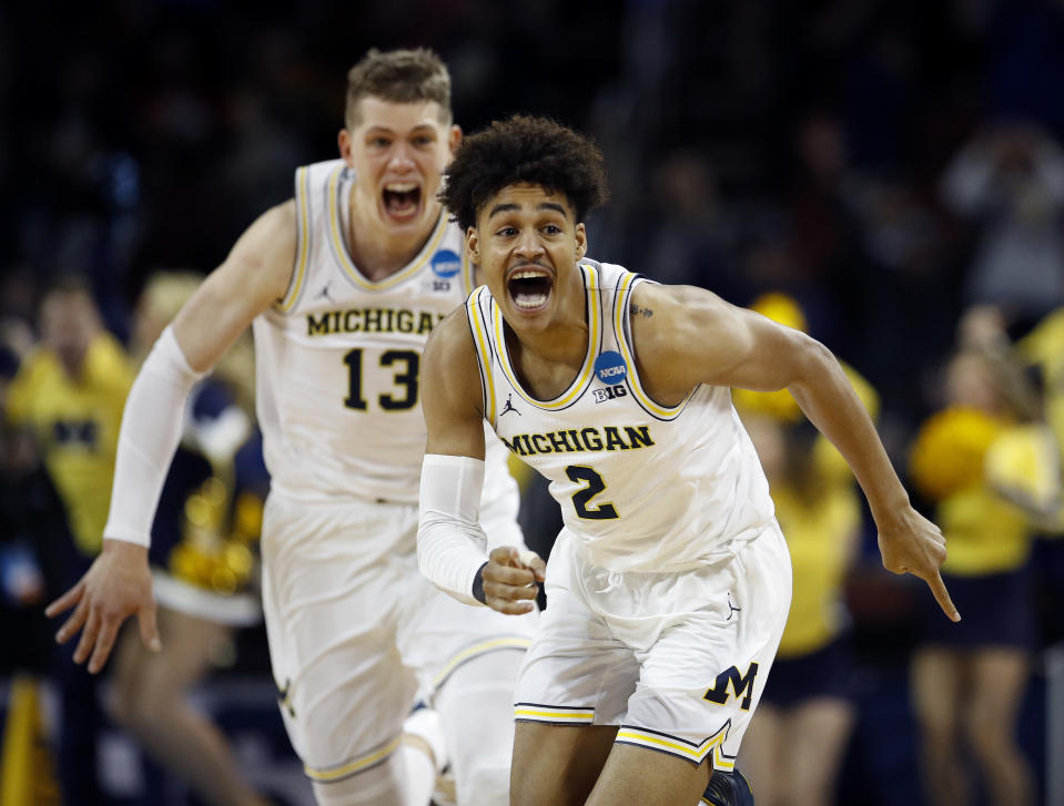 Michigan guard Jordan Poole (2) celebrates with Moritz Wagner after stunning Houston with a buzzer-beating 3-pointer to advance to the Sweet 16. (AP)