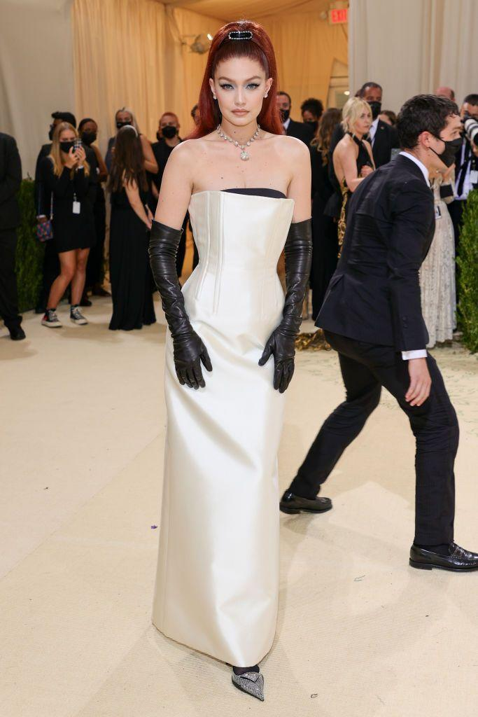 <p>Hadid showed off her new red hair in a Prada look. </p>