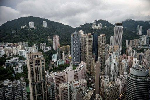 Photo taken on August 13 shows high rises in Hong Kong, including Opus Hong Kong (4th L on the left hill). An apartment in Opus Hong Kong has been sold for a record $61 million, making it the priciest condominium in the Chinese city and possibly the second most expensive in the world, reports said