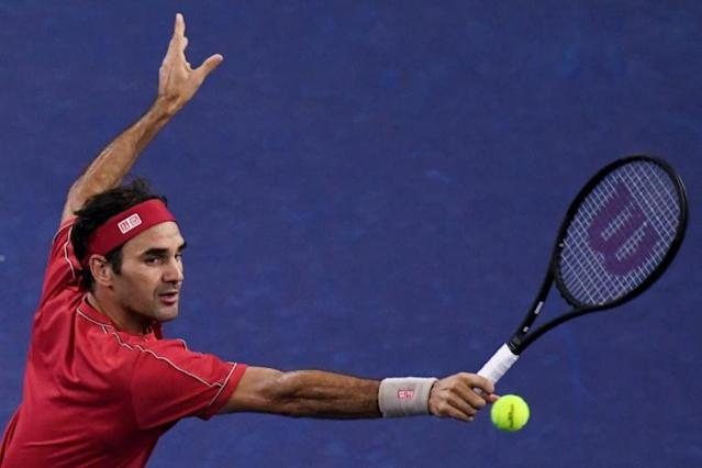 "Roger Federer says the next generation of male tennis stars are ""knocking on the door big time"" (AFP Photo/NOEL CELIS)"