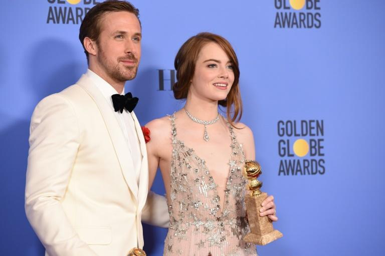 Actors Ryan Gosling and Emma Stone, winners of the Best Performance by an Actor/Actress in a Motion Picture —Comedy or Musical for 'La La Land', pose in the press room at the 74th Annual Golden Globe Awards held on January 8, 2017