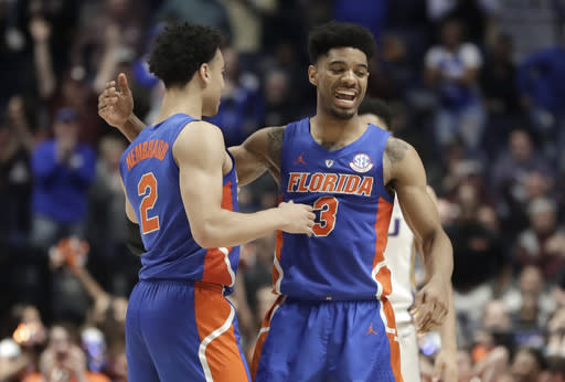 Florida guard Andrew Nembhard (2) is congratulated by Jalen Hudson (3) after Nembhard hit the winning 3-point basket against LSU in the second half of an NCAA college basketball game at the Southeastern Conference tournament Friday, March 15, 2019, in Nashville, Tenn. Florida won 76-73. (AP Photo/Mark Humphrey)