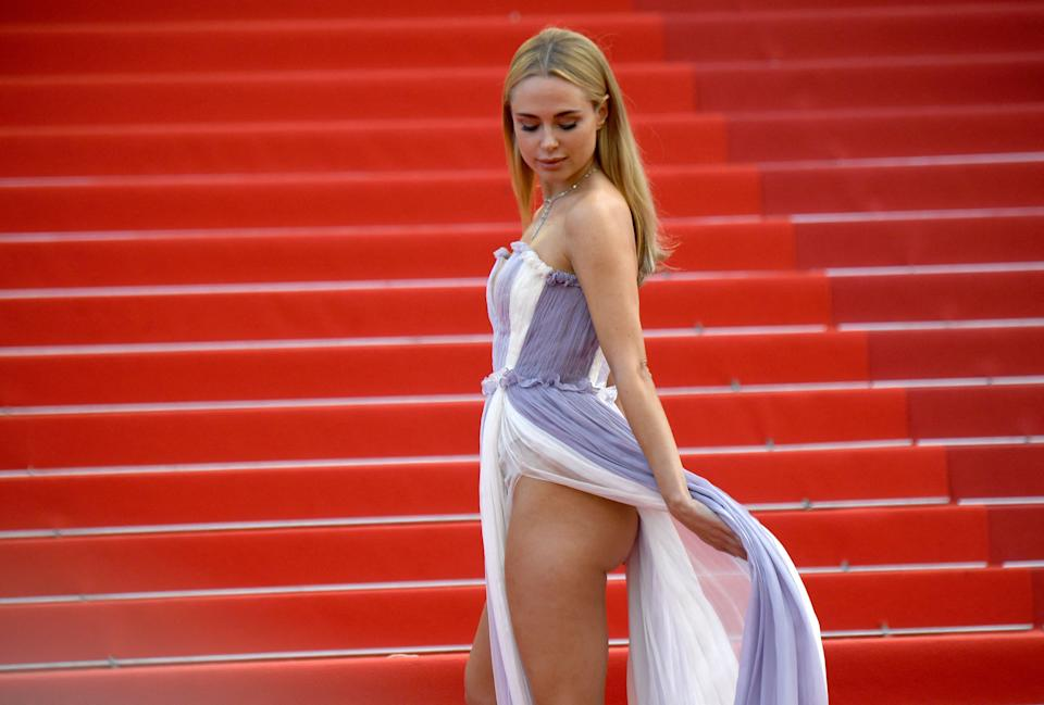 British fashion designer Kimberley Garner wears a lilac and white gown at the screening of the film
