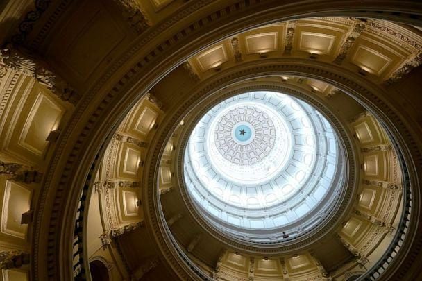 A visitor leans over a railing in the rotunda at the State Capitol on June 1, 2021, in Austin, Texas. The Texas Legislature closed out its regular session Monday. (Eric Gay/AP)