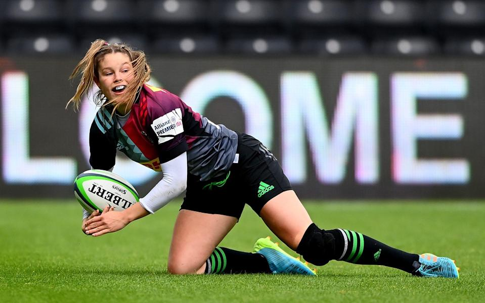 England winger Jess Breach ran in two fine tries but was carried off with what seemed to be a leg injury late on - GETTY IMAGES