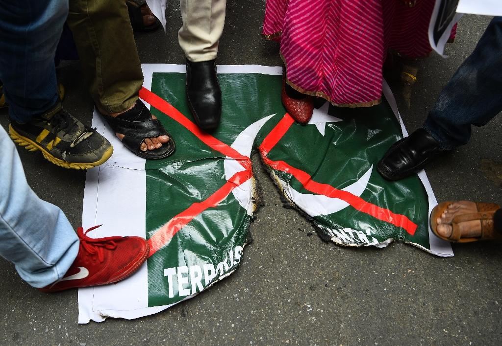 Some demonstrators and TV news channels have demanded military action against Pakistan (AFP Photo/Sajjad HUSSAIN)