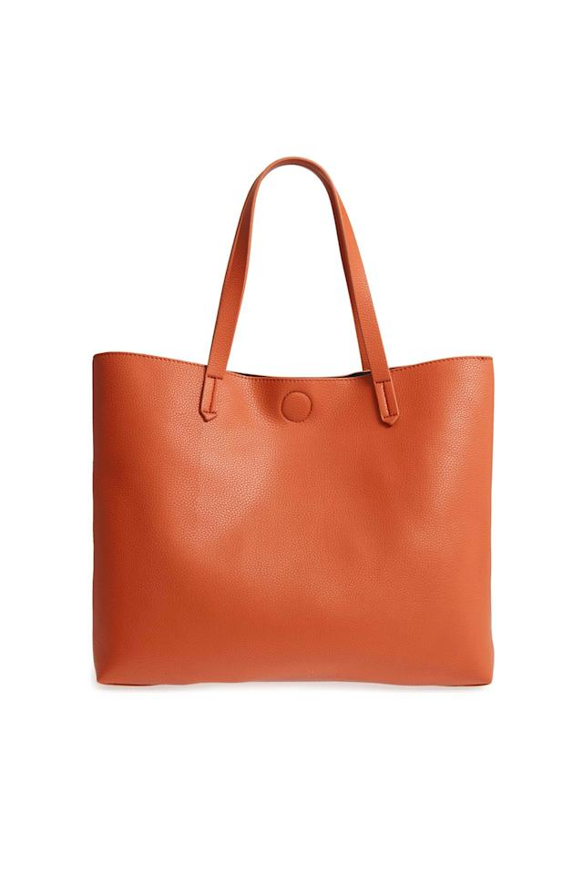 "<p><strong>BP.</strong></p><p>nordstrom.com</p><p><strong>Out of Stock</strong></p><p><a rel=""nofollow"" href=""https://shop.nordstrom.com/s/bp-contrast-lining-faux-leather-tote/4847459"">SHOP NOW</a></p><p>This tote is large enough for <a rel=""nofollow"" href=""https://www.womansday.com/life/g22725787/back-to-school-laptop-deals/"">her laptop</a> and comes with a zippered pouch for keys, <a rel=""nofollow"" href=""https://www.womansday.com/style/beauty/a54102/lipstick-on-face/"">lipstick</a>, and other small knick knacks.</p>"