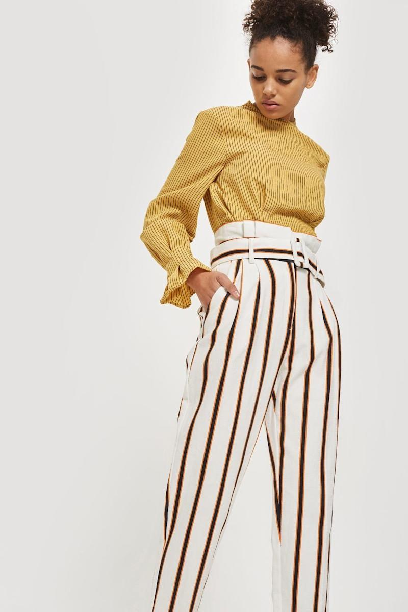 "Get them at <a href=""http://us.topshop.com/en/tsus/product/multi-coloured-stripe-tapered-trousers-7490514?bi=20&ps=20"" target=""_blank"">Topshop</a>, $85."