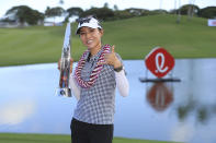 Lydia Ko, of New Zealand, holds the Lotte Championship trophy after winning the golf tournament, Saturday, April 17, 2021, in Kapolei, Hawaii. (AP Photo/Marco Garcia)