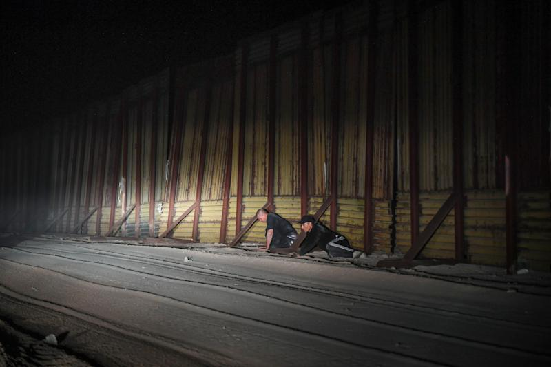 SAN LUIS, Ariz. –As day turns to night, U.S. Border Patrol Agent Jose Garibay drives his SUV east along the southern border wall, his lights turned off so spotters on the Mexican side can't see his vehicle. When he realized two men were crouched low on the U.S. side of the border, he shined his lights on them.