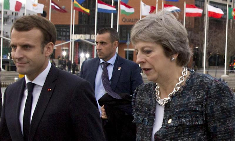 Theresa May and the French president, Emmanuel Macron, arrive at the EU summit in Gothenburg, Sweden.