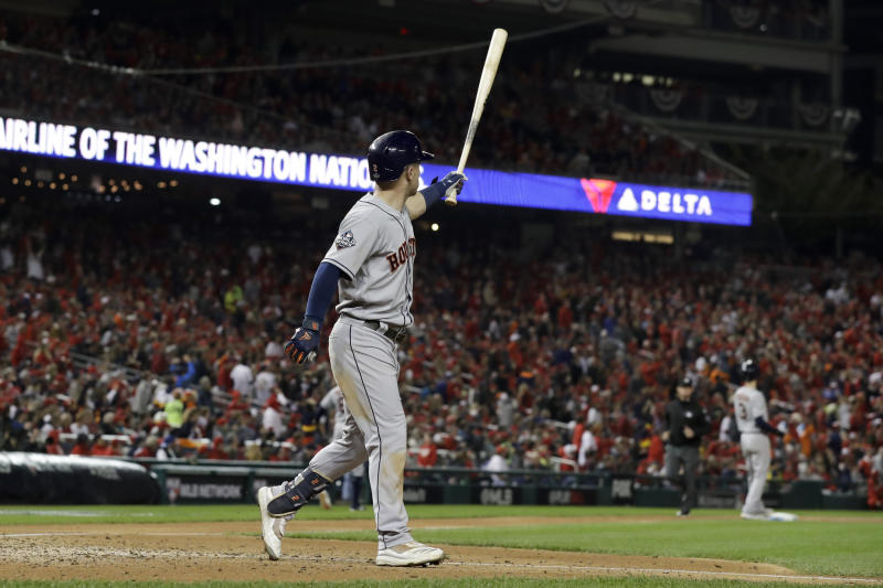 Houston Astros' Alex Bregman watches his grand slam against the Washington Nationals during the seventh inning of Game 4 of the baseball World Series Saturday, Oct. 26, 2019, in Washington. (AP Photo/Jeff Roberson)