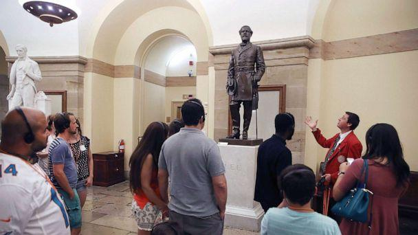 PHOTO: A tour guide talks about the Statue of Confederate General Robert E. Lee that is located inside the Capitol, Aug.17, 2017, in Washington, DC. (Mark Wilson/Getty Images)