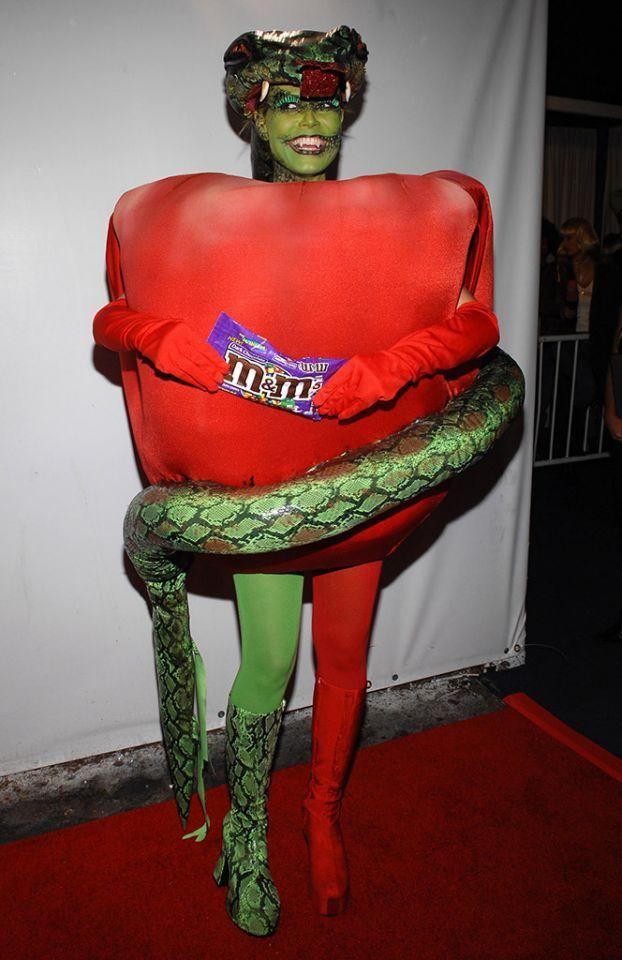 <p>No. 8: This is a sentimental fave. In 2006, the reality TV star was eight months pregnant, and there was speculation that she wouldn't even have a party. But she just can't quit Halloween. Instead, Klum put a creative spin on her costume, dressing as the serpent and the apple from the Garden of Eden. Her then husband, Seal, went as Eve. (Photo: Getty Images) </p>